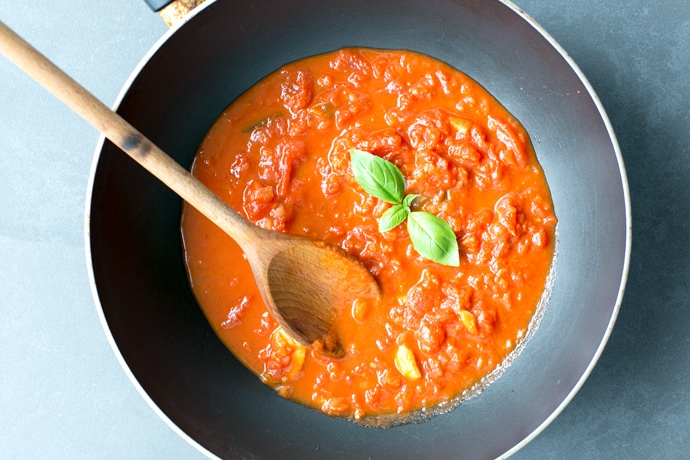 This classic Italian tomato sauce is one of those basic recipes you need to have in your life. It's conveniently vegetarian, dairy-free, vegan and gluten-free, and takes only 5 ingredients and 30 mins to make! Recipe from The Petite Cook