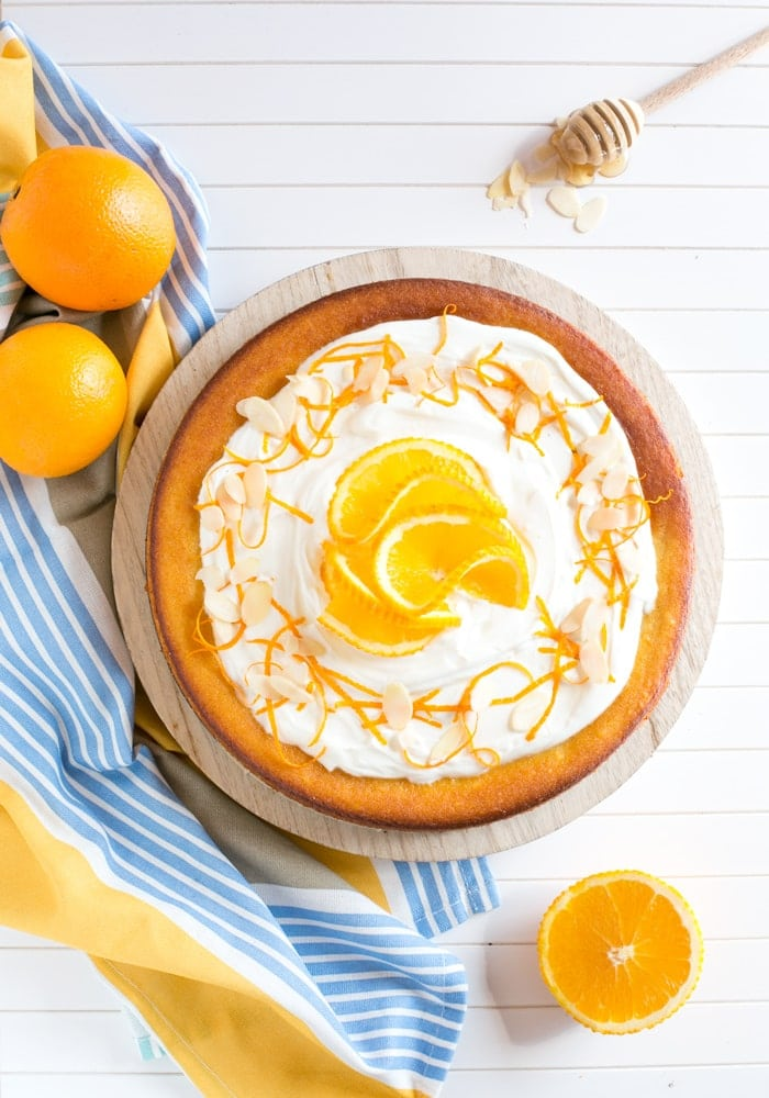 This Flourless Orange Cake is incredibly light and moist - It's also gluten-free and dairy-free, making it the perfect allergy-friendly dessert! Recipe by The Petite Cook