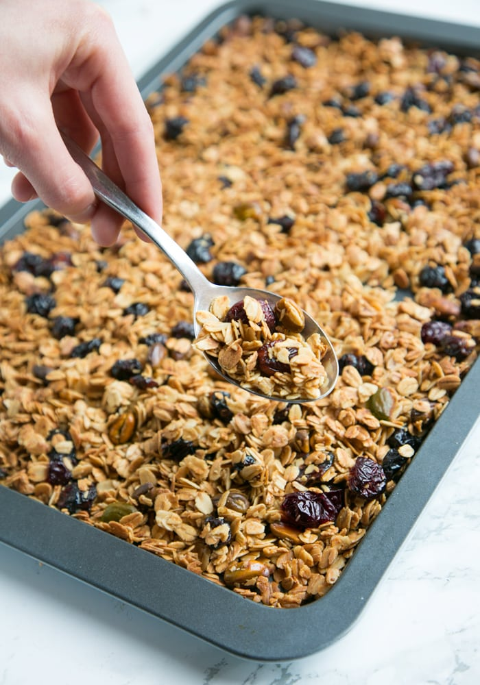 This Christmas Homemade Granola recipe is loaded up with the delicious flavors of the holiday season. Naturally #vegan and #glutenfree, it would also make a pretty homemade gift for someone you love.