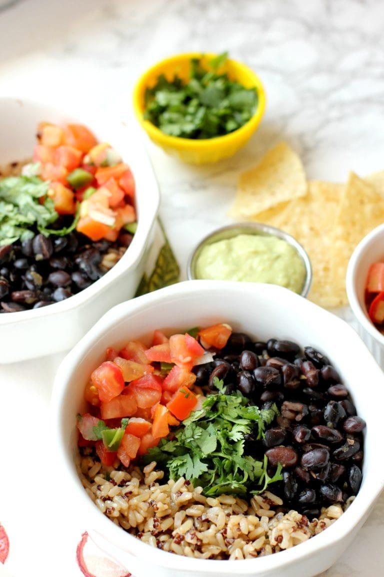 vegan burrito bowl with rice, tomatoes, beans