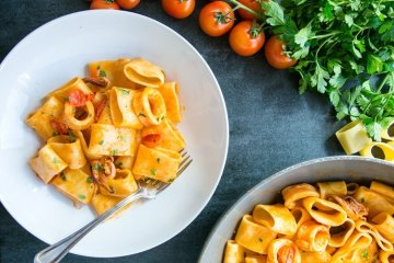 italian calamarata pasta with calamari and tomato sauce