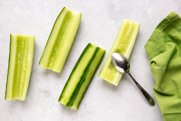 cucumber boats with a spoon and green napkin