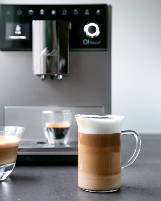 Foodie gift guide: Melitta CI Touch coffee machine , latte macchiato in clear glass cup, espresso in clear mug in the background
