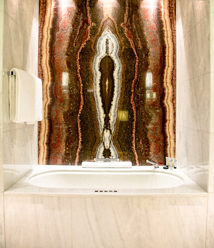 marble bath tube in deluxe room at park hyatt vienna
