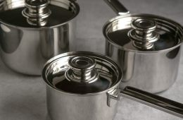 robert welch 3 saucepan set with lids, on grey background