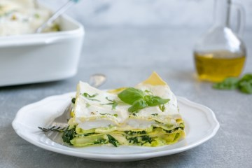 vegetarian lasagna with ricotta white sauce served on a plate