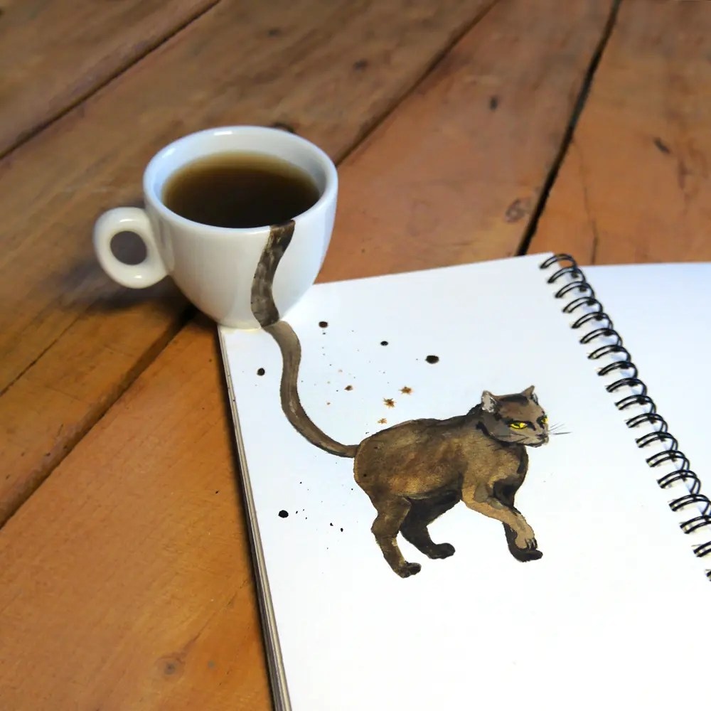Clever Photos Blend Cats Into Coffee Cups