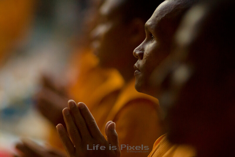 bokeh praying monks