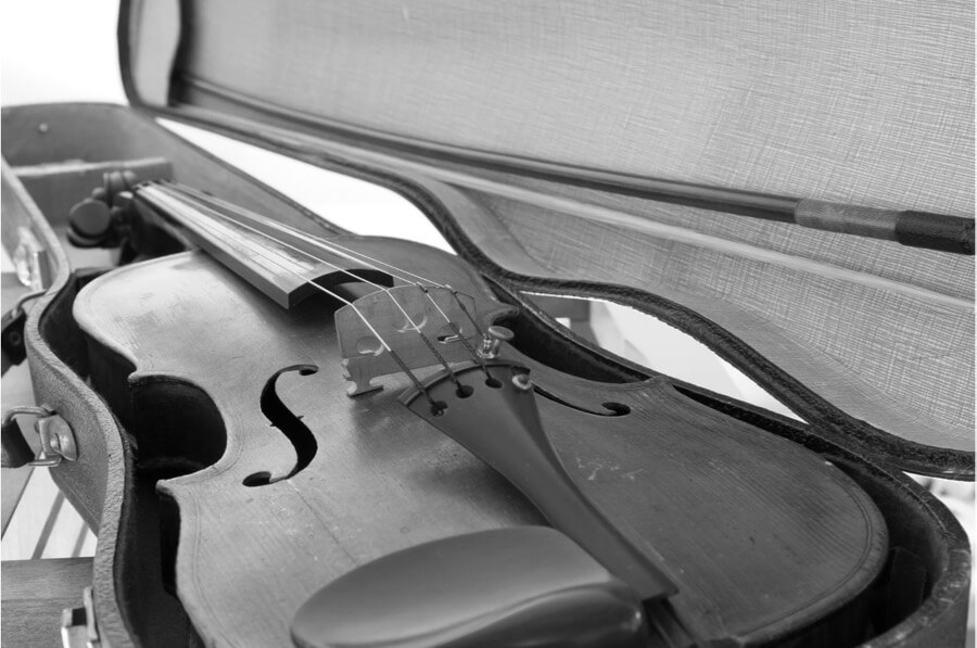 Old violin in flight case