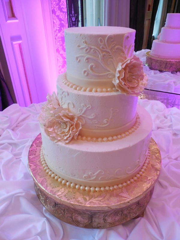 Wedding Cake Cost Considerations That Add Up    The Pink Bride white and blush wedding cake  provided by tricities cake bakery the cake  gallery