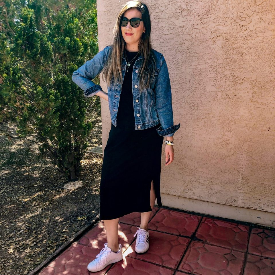 Casual and comfy wearing a black dress with denim jacket