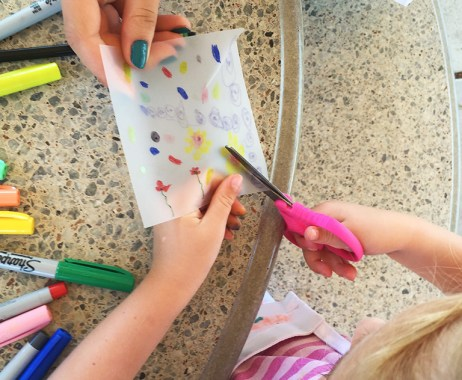 Making pinwheels with mylar paper and a pencil