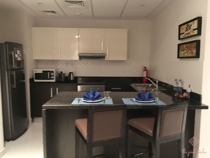 Fully-equipped kitchen with conventional oven, ref, microwave oven, and utensils.