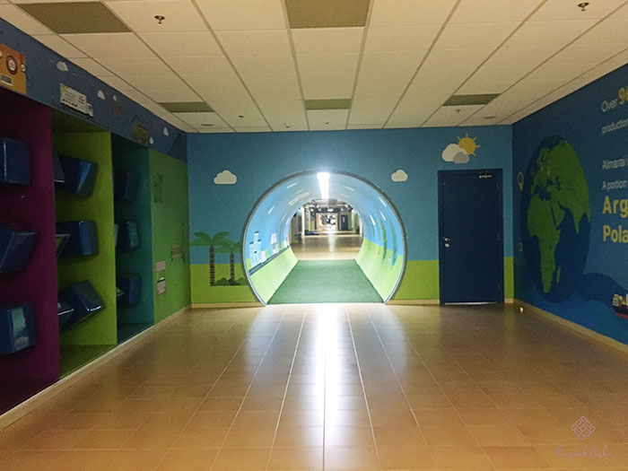 The walkway with a cute tunnel in the middle.