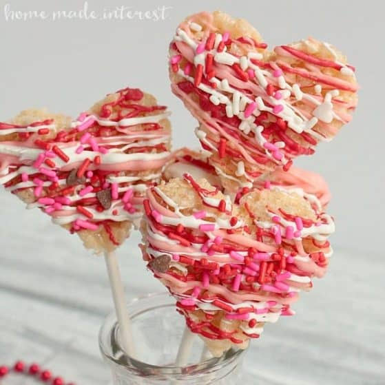 These heart shaped Rice Krispie Treat pops are a fun last minute Valentine's Day treat that you can decorate with your kids.
