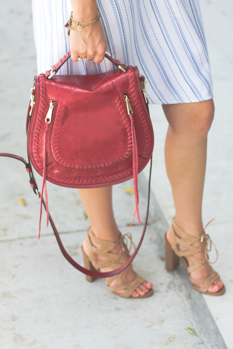 Savannah Jayne styles nude shoes with a bold red bag.