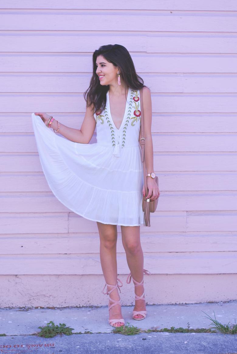 Savannah Jayne twirls in a fun embroidered dress.