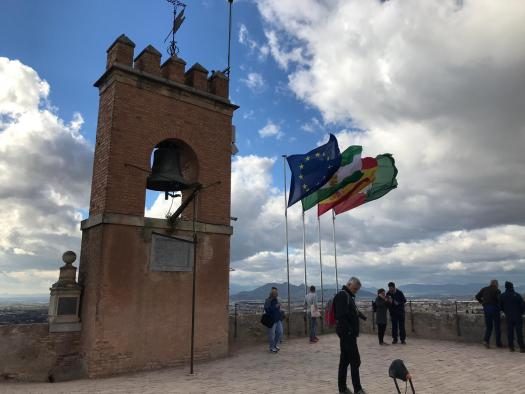 A bell tower and Flags at the top