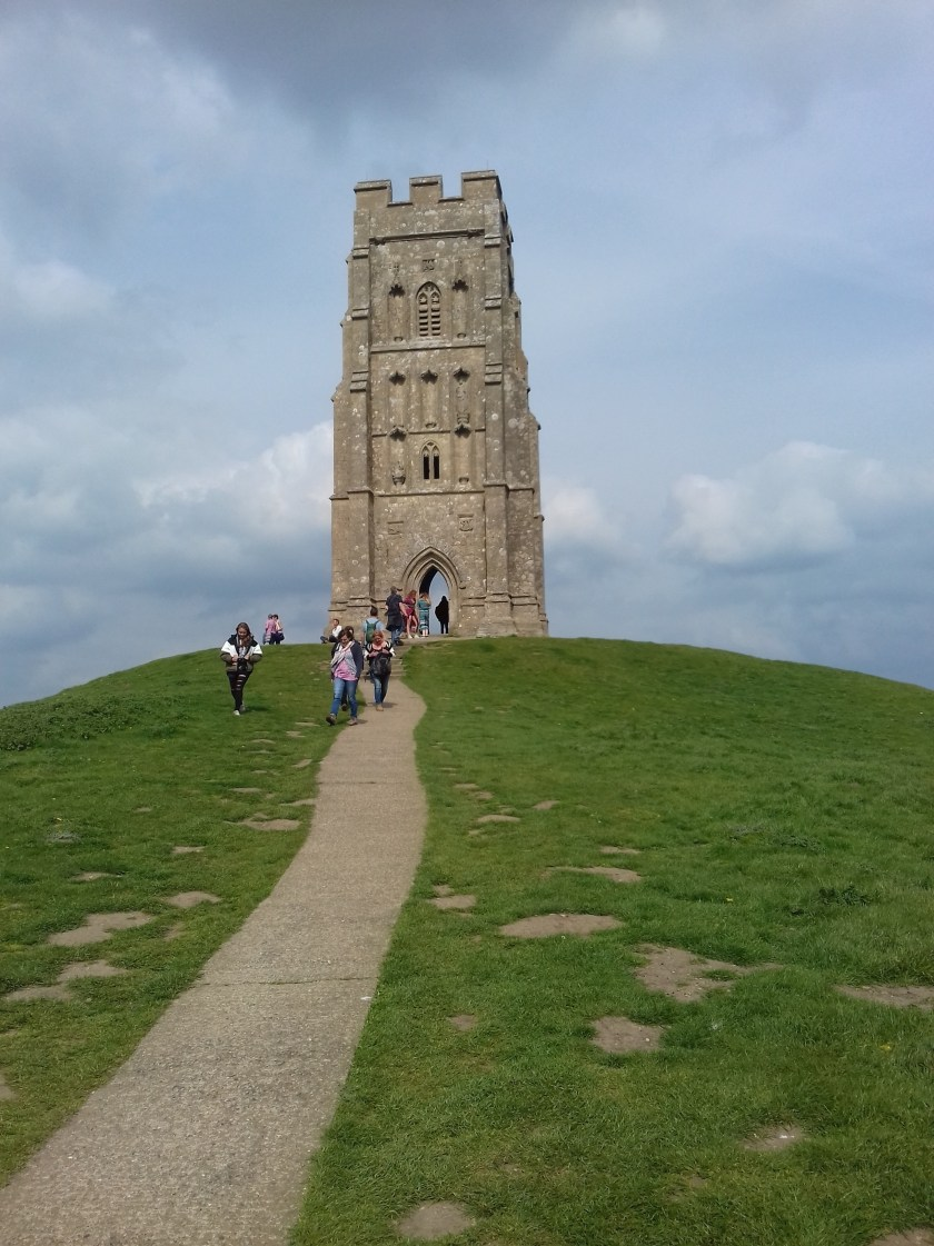 People climbing to the top of the Tor