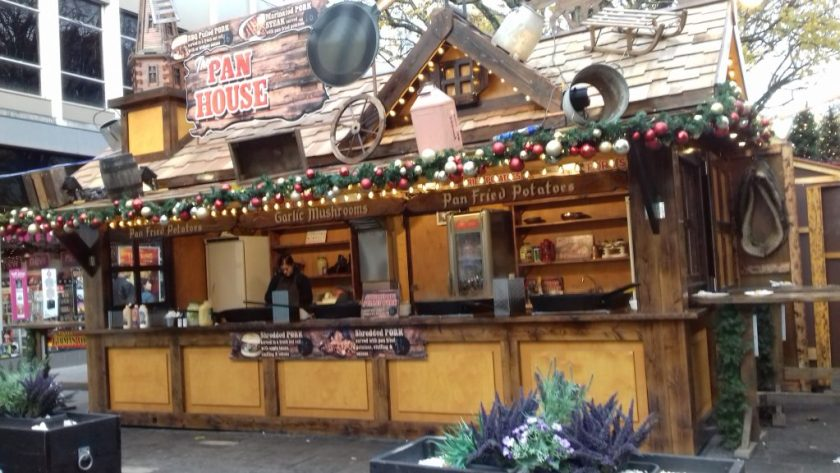 A wooden food stall decorated with a frying pan # Bristol Christmas market
