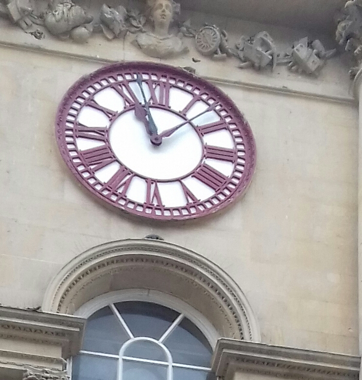 The clock in St. Nicholas Market has two minute hands.