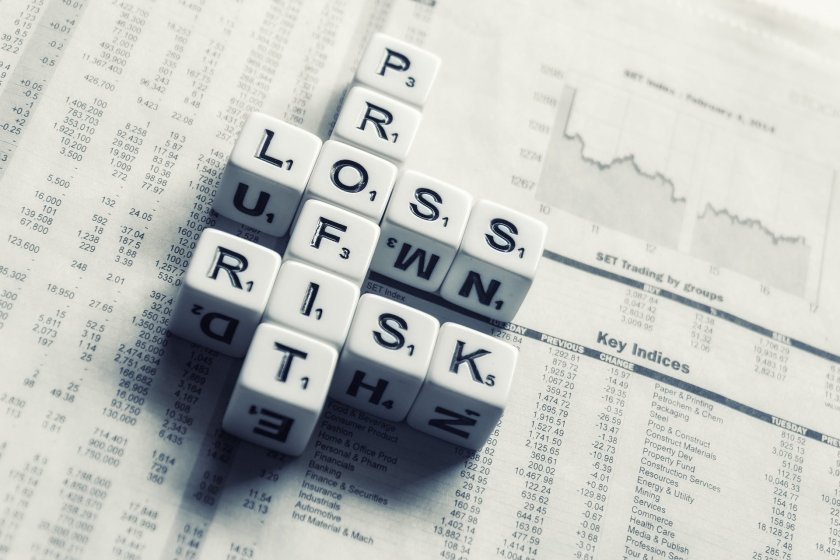 Scrabble tiles displaying profit, loss and risk