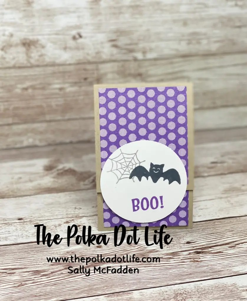 A matchbox style treat holder using Stampin' Up products.  It is purple with white dots and it has a bat on it.  It is one of five Stampin' Up Treat Holders featured on my blog today.