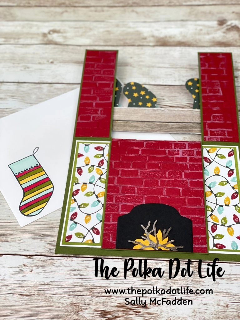 This is a greeting card made by using the Sweet Stockings suite of products by Stampin' Up.  The card is created to look like a fireplace!