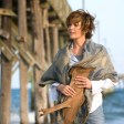 """Adrienne (DIANE LANE) finds a piece of driftwood on the beach in Warner Bros. Pictures' and Village Roadshow Pictures' romantic drama """"Nights in Rodanthe,"""" also starring Richard Gere. PHOTOGRAPHS TO BE USED SOLELY FOR ADVERTISING, PROMOTION, PUBLICITY OR REVIEWS OF THIS SPECIFIC MOTION PICTURE AND TO REMAIN THE PROPERTY OF THE STUDIO. NOT FOR SALE OR REDISTRIBUTION."""