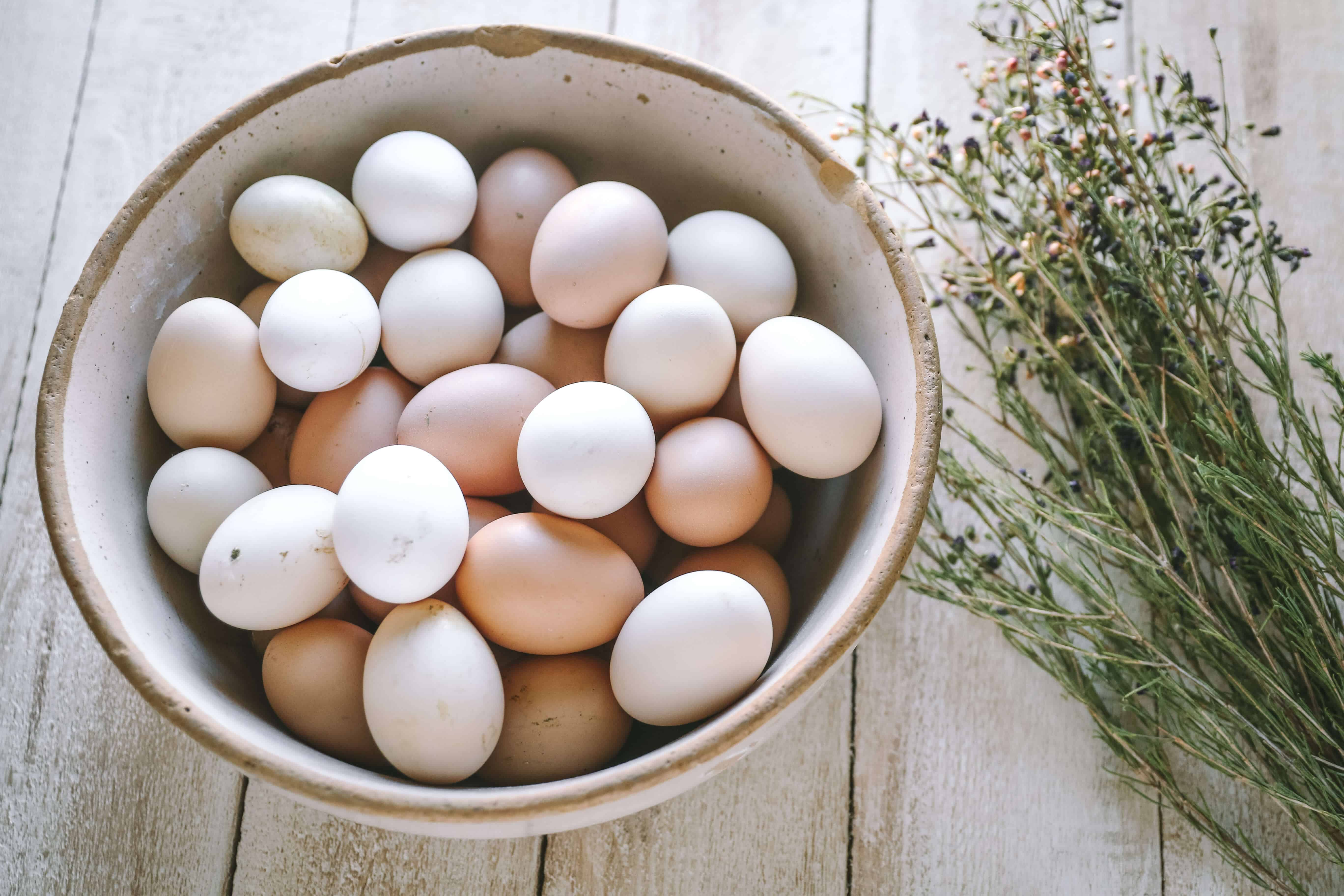 fresh eggs in old bowl