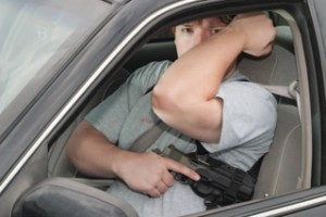 A shoulder holster is an excellent carry rig for driving. But if you have to present your firearm, make sure to not cover your support arm.