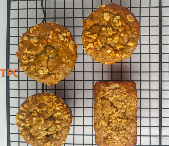 banana bread/banana muffin straight out of the oven, sprinkled with nuts