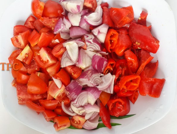 chopped tomato, onions and peppers ready for grinding for Nigerian tomato stew base