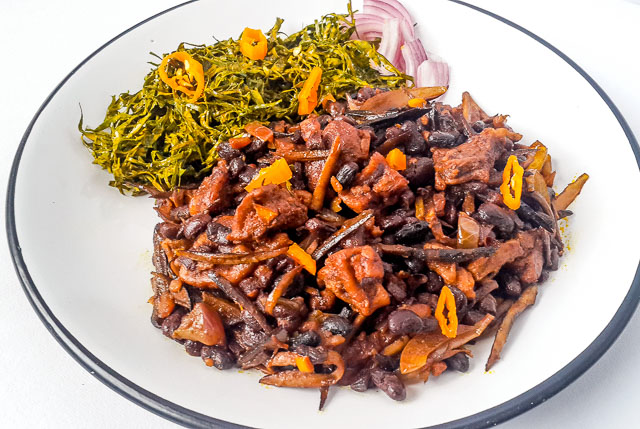 Healthy, vegetarian achicha, dry cocoyam with black beans