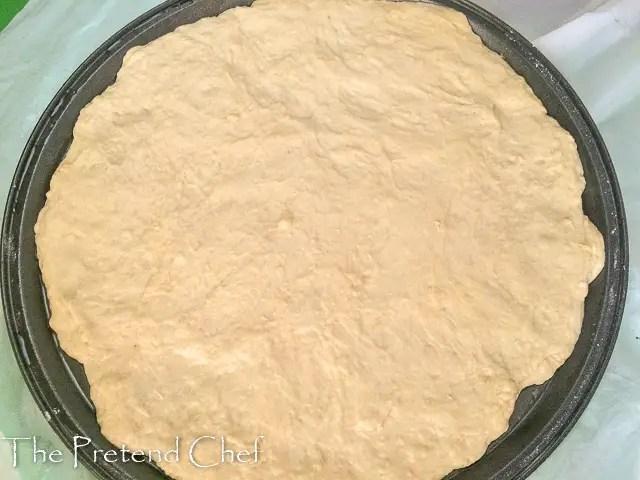 pizza dough on baking tray homemade pizza dough