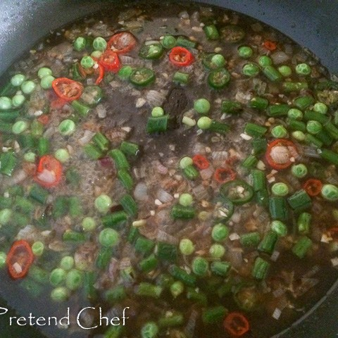 vegetable broth boiling in a pot for vegetable couscous