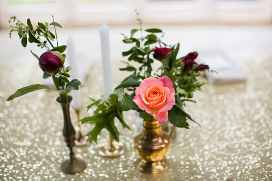 gold sequin table runner and vintage vases