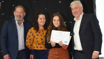 Volunteering since she was 2, Devon youngster win national award