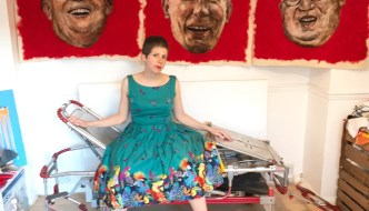 sara vaci sitting on a stretcher in front of three portraits in wool of trump, putin and il
