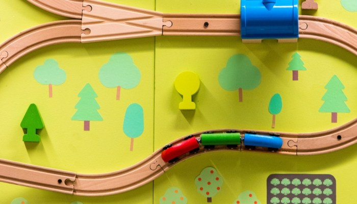 a wooden toy train track from above