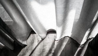 the bottom of net curtains in black and white