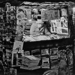 "This French newsstand, in December 1931, has a few pulps hanging on its left side, including ""Argosy,"" ""Blue Book,"" ""Black Mask,"" ""All-Story,"" ""Far West Romances"" and ""Adventure."""