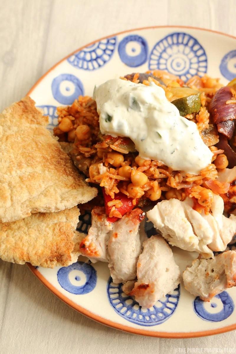 Roasted Vegetable, Chick Pea & Rice Salad with chicken kebabs and pita bread
