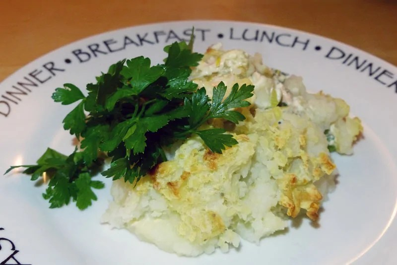 Slimming World Fish Pie Recipe. Fish pie portioned onto a plate with parsley garnish