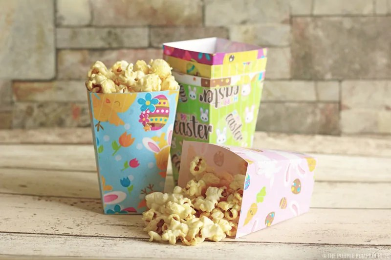 These free printable Easter popcorn boxes are so cute, and easy to make! Just download the free printables (6 different Easter designs), print, cut, fold, and stick together to form the popcorn box. The best part is filling each one with yummy popcorn! #EasterPopcornBoxes #FreePrintables #PopcornBoxes #EasterPopcorn #EasterPrintables