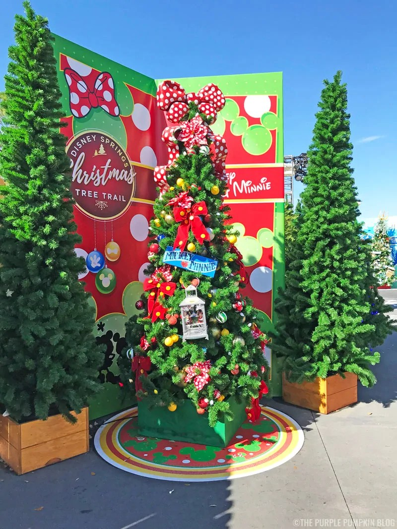 Mickey & Minnie Christmas Tree topped with a red and white polka dot bow.