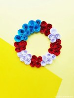 red white and blue paper roses flower wreath on a yellow background