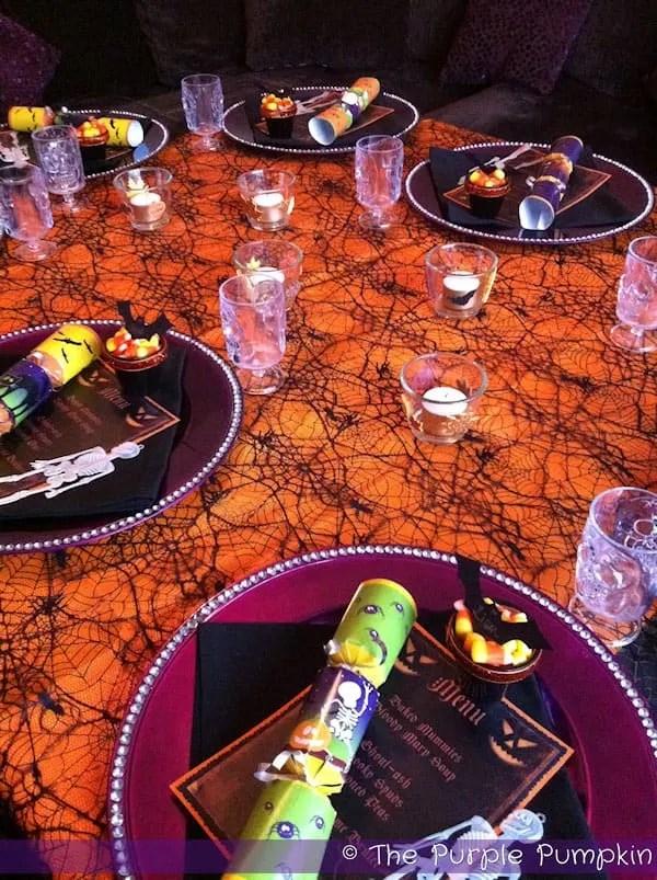 Halloween menus sitting on dinner plates