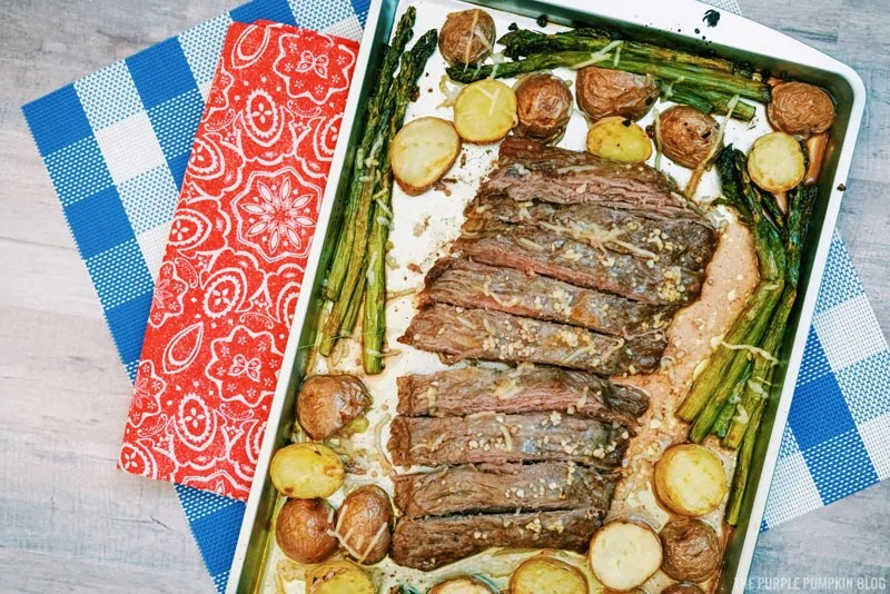 Sheet Pan Steak Dinner on a table with red, and blue napkins.