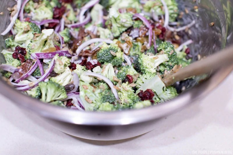 All broccoli bacon salad ingredients mixed together in a bowl.